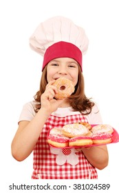 happy little girl cook with donuts