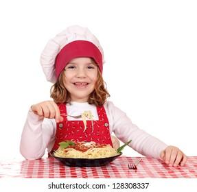 happy little girl cook eat spaghetti