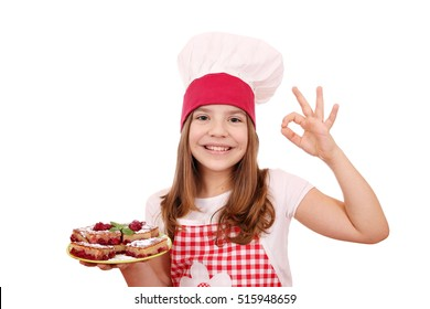 happy little girl cook with homemade cake and ok hand sign