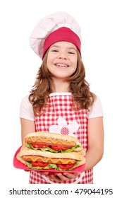 happy little girl cook with hot dogs on plate