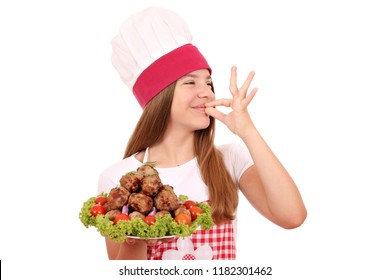 happy little girl cook with meatballs on plate and ok hand sign