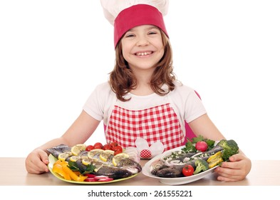 happy little girl cook with prepared fishes