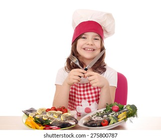 happy little girl cook with prepared trout ready for lunch