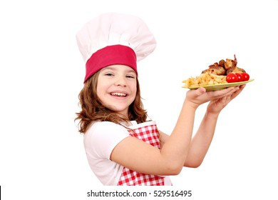 happy little girl cook with roasted chicken wings on plate