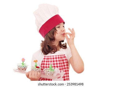 happy little girl cook with sweet muffin