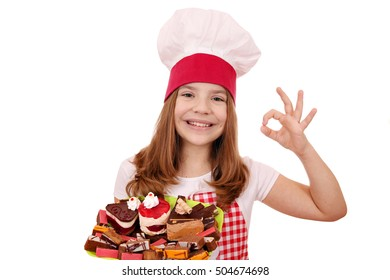 happy little girl cook with sweet cakes andok hand sign