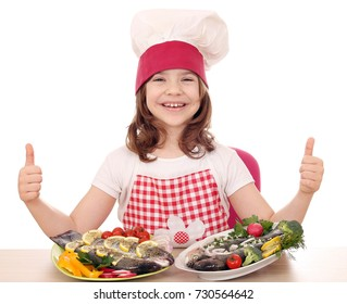 happy little girl cook with trout on plate and thumbs up