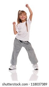 Happy little girl dancing isolated on white background