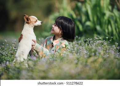 Happy little girl with dog