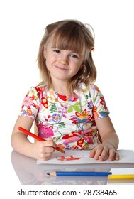 happy little girl drawing a picture on white