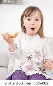 happy little girl eating