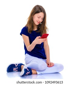 Happy little girl enjoys a smartphone. The concept of people and technology. Isolated on white background.