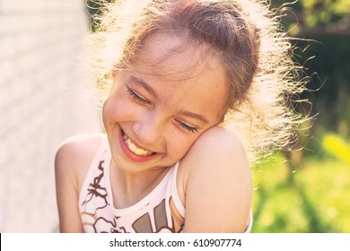 Happy Little girl excited. Cute preteen Girl smiling very happy, surprised  on Summer background. Beautiful Child joyful at Sunset.