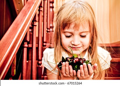 Happy little girl with fake cherry berry - healthy diet concept. Healthy since childhood