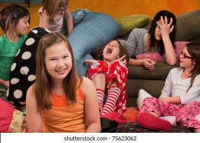Happy little girl with friends at a sleepover