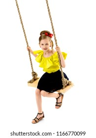 Happy little girl gaily swinging on a swing. The concept of a summer vacation in nature, a family vacation with the family on the beach or the sea. Isolated on white background.