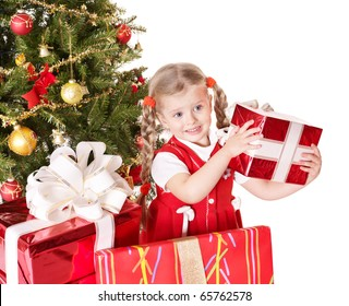 Happy little girl giving gift box by christmas tree Isolated.