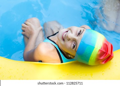 Happy little girl have a nice time in swimming pool