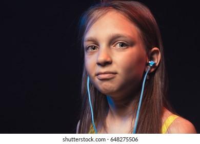 Happy little girl with headphones