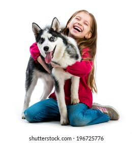 happy little girl is with her dog husky isolated on white