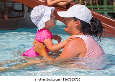 Happy little girl with her mom on summer holidays