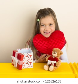 Happy Little Girl with Her Valentine Day Presents