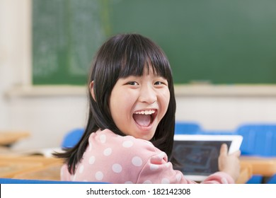 happy little girl holding digital tablet ipad