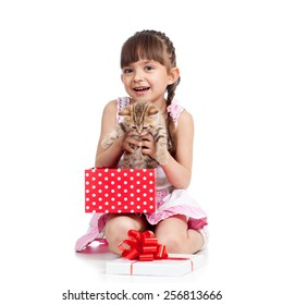 happy little girl holding gift box with kitten isolated
