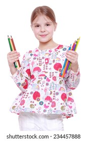 Happy little girl holding pencils/Studio portrait of a beautiful cheerful little girl with colored pencils on Education