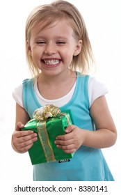 The happy little girl holds a gift