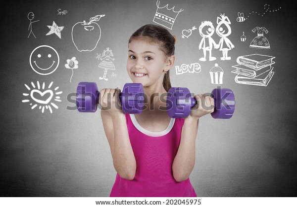 Happy little girl lifting dumbbells, smiling cheerful, fresh, energetic, isolated black background with graphics. Summer time, vacation, active life style concept. Positive emotions, face expression