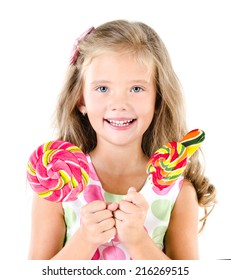 Happy little girl with lollipops isolated on white