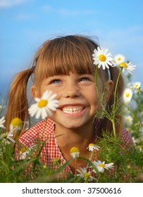 Happy little girl lying in field of flower and have fun