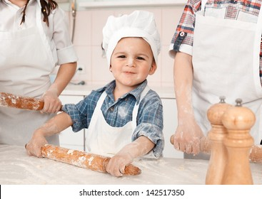 happy little girl making pizza dough