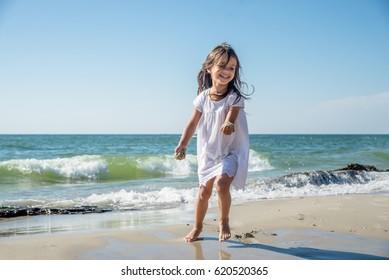Happy little girl on the beach