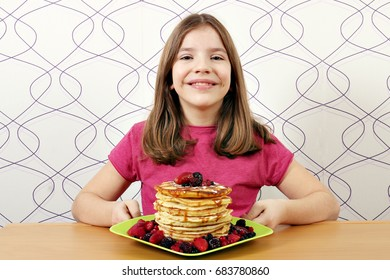 happy little girl with pancakes