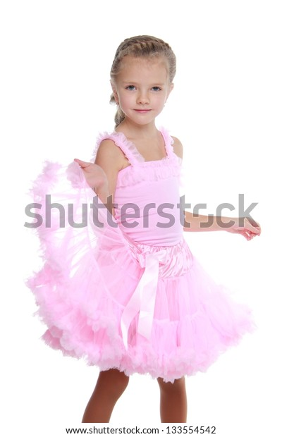 Happy little girl in a pink fluffy skirt with a beautiful long braid on white background
