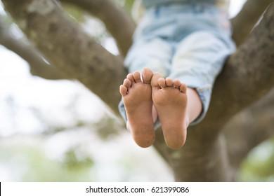 Happy little girl playing barefoot