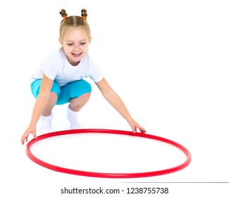 Happy little girl playing with a hoop. The concept of a happy childhood. Isolated on white background.