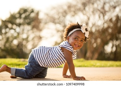 Happy little girl playing outside.