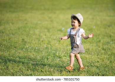 Happy Little Girl Playing in the Prairie