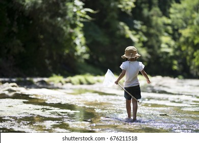 Happy Little Girl playing in the river