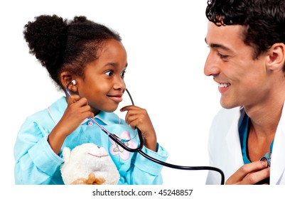 Happy little girl playing with the stethoscope and listening the heart of the doctor