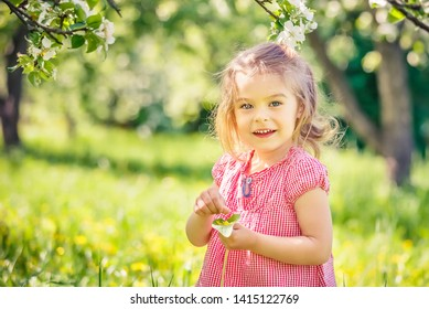 Happy little girl playing in sunny park
