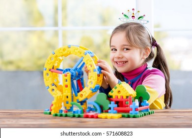 Happy Little Girl Playing With Toys At Home