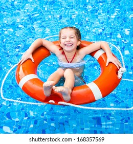 happy little girl in the pool floating on the Lifebuoy