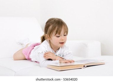 happy little girl reading book