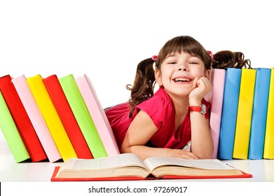 Happy little girl reading a book on the floor. Isolated on white background