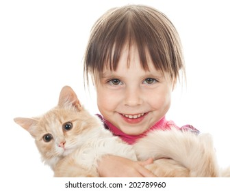 Happy little girl with a red kitten on the white background