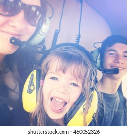 Happy little girl riding in helicopter with family - Instagram effect